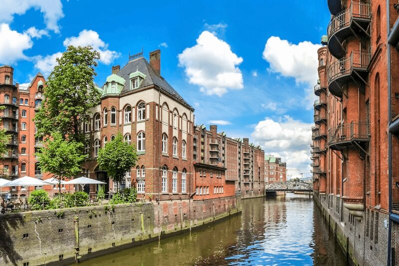 A canal in Hamburg, Germany lined with red brick buildings